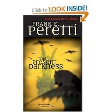 book This Present Darkness Publisher: Living Books; Reprinted edition