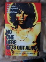 No One Here Gets Out Alive: The Celebrated Biography of Jim Morrison by Jerry Hopkins, Daniel Sugerman (January 1, 1997) Hardcover